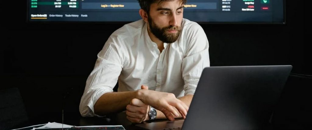 Man Researching on Computer